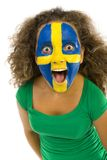 Wow!. Young screaming Swedish fan with painted flag on faces. She's on white background Stock Photography
