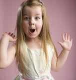 Wow. A very happy excited little girl stock images