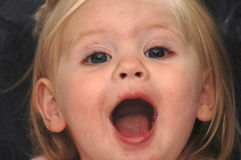 Wow. A picture of a baby girl whose mouth is open in exclamation royalty free stock photo