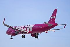 WOW air Airbus A321-200 Passing By. A WOW air Airbus A321-200 is shown coming in for a landing at Toronto Pearson International Airport. The Iceland based ultra royalty free stock photography