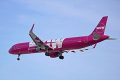 WOW air Airbus A321-200 Side View. A WOW air Airbus A321-200 is shown coming in for a landing at Toronto Pearson International Airport. The Iceland based ultra royalty free stock photography
