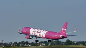 Wow Air takes off from Amsterdam Schiphol Airport, AMS. WOW air is an Icelandic low-cost carrier operating services between Iceland, Europe and North America stock photos
