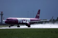 Wow Air landing on Netherlands, AMS Amsterdam Airport Schiphol. WOW air jet is landing on Amsterdam Airport AMS stock images
