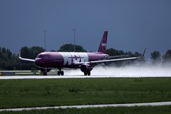 Wow Air landing on Netherlands, AMS Amsterdam Airport Schiphol. WOW air jet is landing on Amsterdam Airport AMS stock photography