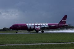 Wow Air landing on Netherlands, AMS Amsterdam Airport Schiphol. WOW air jet is landing on Amsterdam Airport AMS stock photos