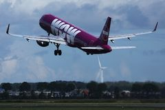 Wow Air landing on Netherlands, AMS Amsterdam Airport Schiphol. WOW air jet is landing on Amsterdam Airport AMS, evening view royalty free stock photos