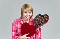 WOW, all these for me. Woman showing appreciation for gift box of valentines day chocolates Royalty Free Stock Image