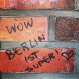 Wow Berlin ist super!. High praise for the city scrawled on a Berlin wall Stock Images