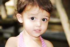 Wow Expression. Beautiful little toddler girl looking with her big brown eyes Stock Photo