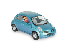 Wow expression of a boy in the blue car Stock Images