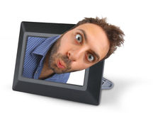 Wow expression with digital photo frame. Young boy with a surprised expression in digital photo frame royalty free stock photo