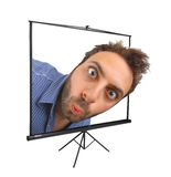 Wow expression on projection screen. Young boy with a surprised expression on projection screen royalty free stock images