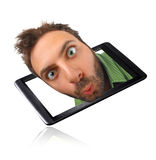 Wow expression with tablet Royalty Free Stock Images