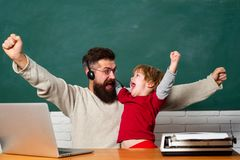 Wow. Future dream and people concept. Happy family. Man teaches child. Age and Ageing. Teacher helping kids with their. Homework in classroom at school. Happy royalty free stock images