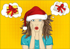 Wow. Girl in Santa Claus hat very surprised. Young woman with he Stock Photo