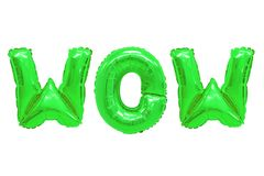 Wow green color. Word wow in english alphabet from green balloons on a white background. holidays and education royalty free stock images