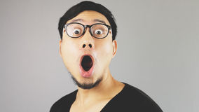 Wow guy. An asian man with black t-shirt royalty free stock photography