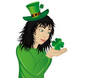 Wow! Happy girl in a hat and suit clover on St. Patrick`s Day Stock Images