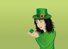 Wow! Happy girl in a hat and suit clover on St. Patrick`s Day Royalty Free Stock Image