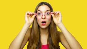 Wow! I don`t believe you! Close up portrait of shocked astonished woman with open mouth and big eyes, she is touching her stock photo