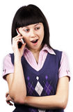 Wow!I'm shocked!. Young woman talking on mobile phone, in shock, over white background royalty free stock photography