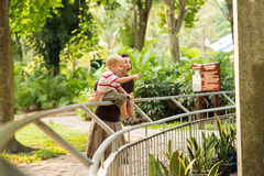 Wow!!. Image of an excited mother and her son in the zoo royalty free stock photography