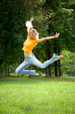 Wow jump of funny woman. Wow jump of funny lovely woman outdoors royalty free stock image