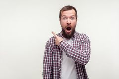 Free Wow, Look There! Portrait Of Shocked Bearded Man Pointing Finger To The Side Up, Empty Space. Isolated On White Background Stock Photos - 168243543