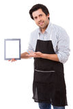 WOW ! Look at this!. Young cooker presenting a new recipe or a cuisine app on a tablet computer Royalty Free Stock Photos