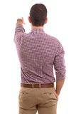 WOW ! Look at that!. A young man with his back turned to camera, pointing to something Royalty Free Stock Photography