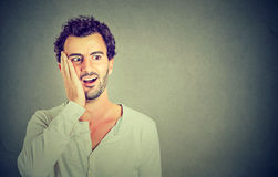 Wow. Man looking excited holding his mouth opened, shocked surprised stock photos