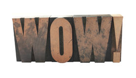'wow' in old wood type. Old, inkstained wood letterpress type spells out the word 'wow' in all caps with an exclamation point royalty free stock image