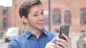 Wow, Outdoor Portrait of Surprised Young Man Using Smartphone. 4k high quality, 4k high quality stock video footage
