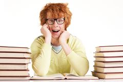 Wow. Portrait of astonished student in eyeglasses looking at camera while reading royalty free stock images