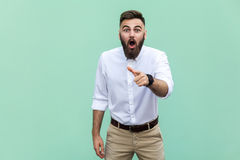Wow that`s great! Portrait of young adult with beard with shocked facial expression. Indoor, studio shot Royalty Free Stock Photo