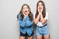 Wow. It`s unbelievable, you are liar. Portrait of two attractive charming happy beautiful wondered surprised girlfriends dressed royalty free stock images