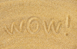 Wow sulla sabbia Immagine Stock