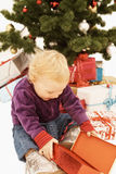 Wow - Surprised kid opening christmas gifts Royalty Free Stock Image
