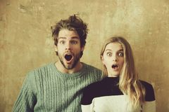 Wow Surprised man and woman with open mouth, young couple. Wow Surprised men and women with open mouth, young couple royalty free stock images