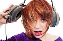 Wow way too loud. Loud music - girl with headphones isolated on white Royalty Free Stock Images