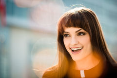 Wow - woman portrait. Portrait of smiling woman looking away making wow with flare reflections Royalty Free Stock Photo