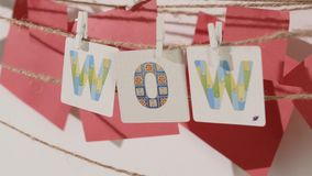 WOW word collected by child hand from paper cards stock video footage