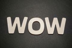 Wow. Expression in white letters on black background text illustration type graphic royalty free stock photography