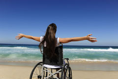 Wowoman in wheelchair enjoying beach Stock Photos