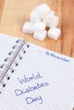 Wpisowy Światowy cukrzyca dzień w notatnika i cukieru sześcianach, symbol cukrzyk zdjęcie stock
