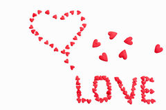 Wpisowy ` miłości ` robić mali serca na białym tle Obrazy Royalty Free