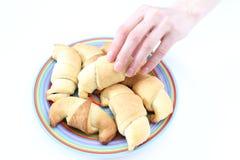 Wręcza brać świeżych croissants na białym tle Zdjęcie Stock