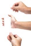 Wręcza chwytowi wirtualną wizytówkę Lub papier Odizolowywających na bielu 3 obrazy royalty free