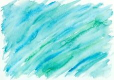 Wręcza malującego abstrakcjonistycznego akwareli tło w błękicie i zieleni obrazy stock