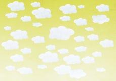 Wręcza malującej akwareli żółte nieba i bielu chmury zdjęcia royalty free